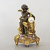 A louis xvi-styel table clock around 1900.