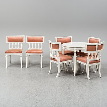 A gustavian style table and six chairs. First half of the 20th century.
