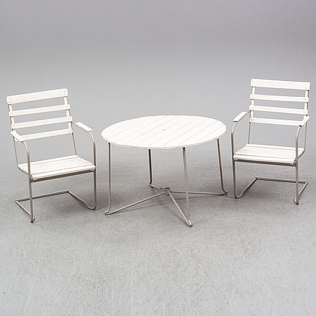 A garden table and two armchairs, mid 20th century.