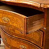 A mid 18th century late baroque chest of drawers.