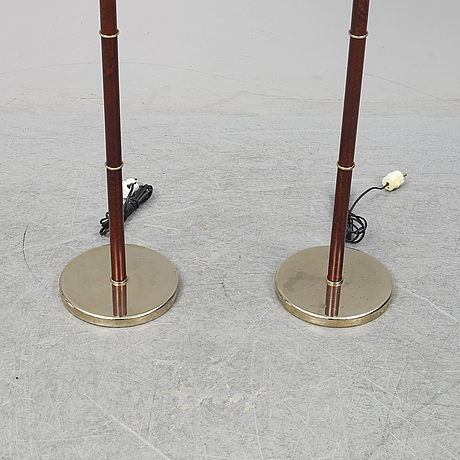A pair of belid floor lights, late 20th century.