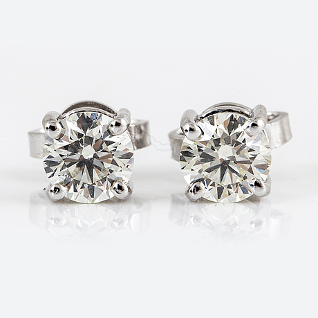 Brilliant-cut diamond earrings, totalt 1,11 ct,  k/vs-si-p.