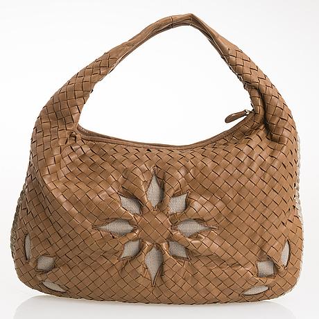 Bottega veneta, a flower veneta bag.