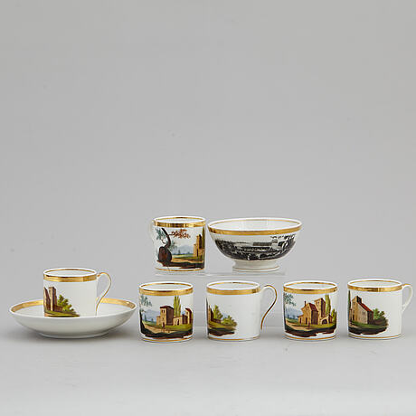 A group of seven cups, one with dish, germany and france, 19th century.