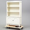 A gustavian style bookshelf, first half of the 20th century.