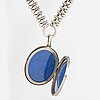 A locket with partly silver and enamel.