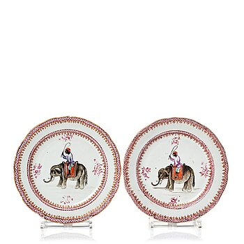 803. A pair of famille rose European Subject dinner plats with elephants, Qing dynasty, Qianlong (1736-95).