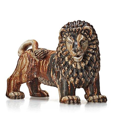 """Gunnar nylund, a stoneware sculpture of a lion, """"leo"""" rörstrand, sweden 1940's."""