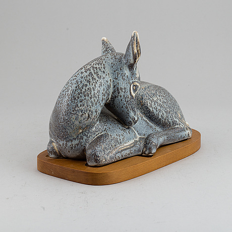 Gunnar nylund, a unique stoneware sculpture of a reclining deer, rörstrand, sweden mid 20th century.