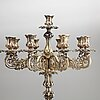 A pair of barocque style nine lights candelabra, silver plate, 20th century.