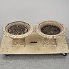A pair of cast iron plat pots.