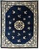 A semiantique chinese carpet ca 355 x 268 cm.