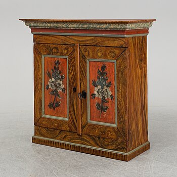 A 18/19th Century painted cabinet.