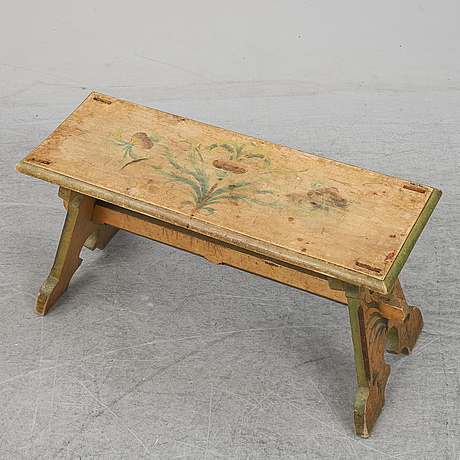 A painted wooden bench from the early 20th century.