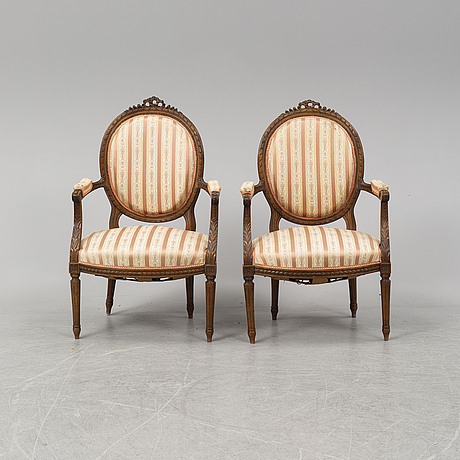 A pair of louis xvi-style armchairs from around year 1900.