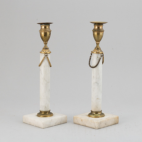 A pair of late gustavian candle sticks.