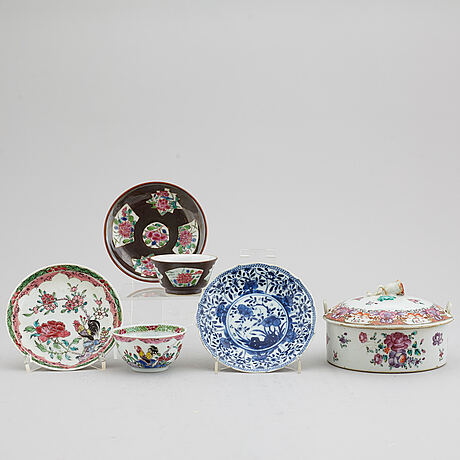 A famille rose butter tureen with cover and two cups with three odd stands, qing dynasty, qianlong (1736-95).