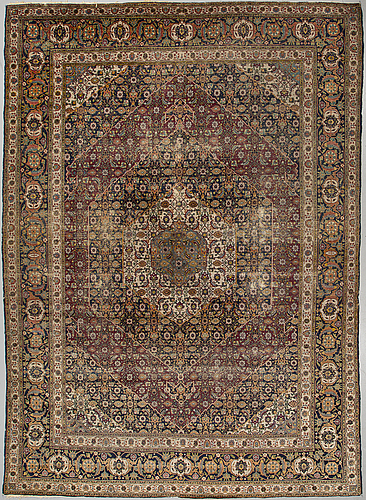 A carpet, semi-antique tabriz, probably, ca 400 x 300 cm.