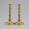 A pair of late gustavian bronze candlesticks, early 19th century.