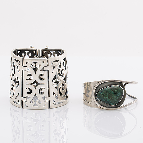 2 silver bracelets, 1 with a green stone, wider bracelet swedish import mark, original invoice dated 1977.