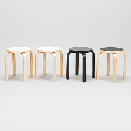 Alvar aalto, four 'e60' stools for artek from late 20th century and 2017.
