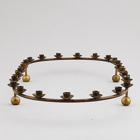 A mid 20th century brass candle ring.