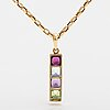 An 18k gold necklace with a garnet, peridote, amethyst and topaz.