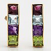 A pair of 18k gold earrings with a garnet, amethyst, topaz and peridote.