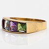 An 18k gold ring with an amethyst, garnet, topaz and peridote.