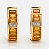 A pair of 18k gold earrings with yellow sapphires and ca 0.01 ct of diamonds.