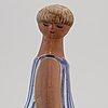 Lisa larson, a 'dora' stoneware figurine, from abc-flickorna, gustavsberg.
