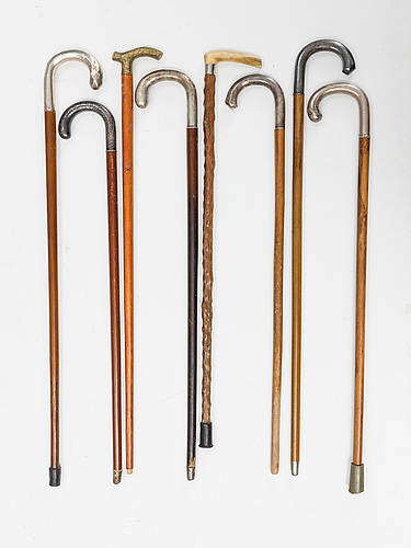 A set of eight canes, frist half of the 20th century. (6 of them with silver details).
