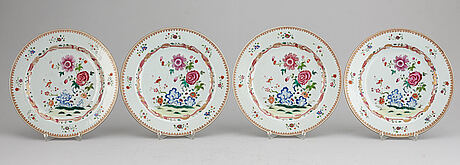 A set of four famille rose dinner plates, qing dynasty, qianlong (1736-95).
