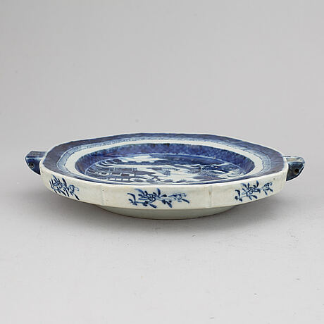 A set of three blue and white plates and a hot water dish, qing dynasty, 18/19th century.