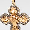 A14k gold pendant/cross with diamonds ca 1.15 ct in total. pertti tevilin, helsinki 1997.