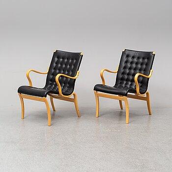 A pair of 'Mina' chairs designed by Bruno Mathsson, Bruno Mathsson International, Värnamo, Sweden.