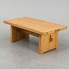 A late 20th century pinewood coffee table.