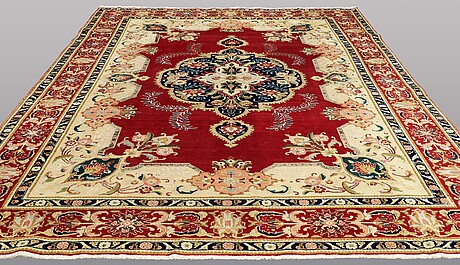 A carpet, old tabriz, ca 390 x 286 cm.