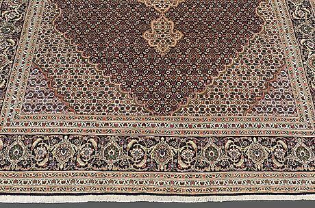 A carpet, tabriz part silk , so called 40 radj, ca 298 x 202 cm.