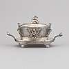 An 'egyptian empire style' silver plated caviar bowl with a blasted glass canister, ca 1900.