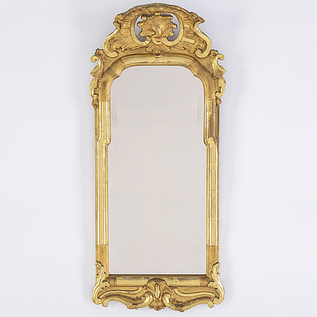 A first half of the 20th century rococo style mirror.