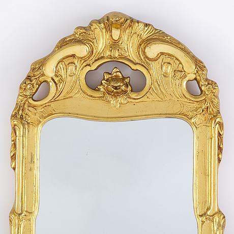 A second half of the 20th century rococo style mirror.