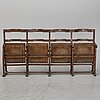 A pair of benches from the early 20th century.