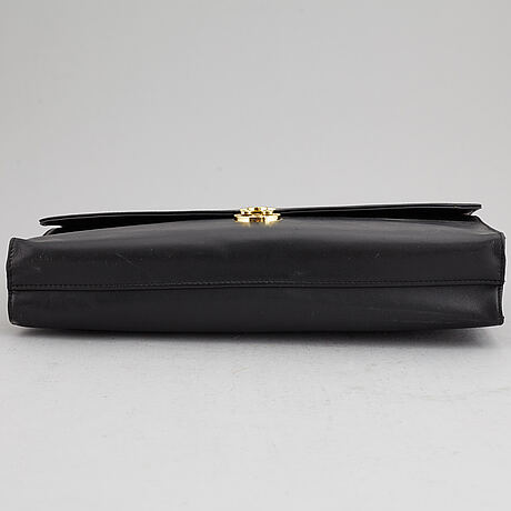 Montblanc, a black leather briefcase.