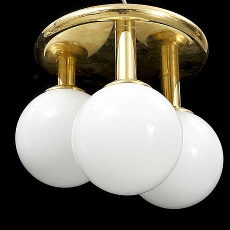 A contemporary brass and glass ceiling light.