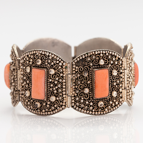 A silver bracelet with corals.