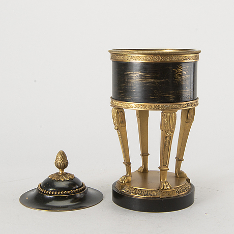 An app. 1900 empire style box with lid on foot.