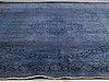An oriental carpet, ca 408 x 299 cm.