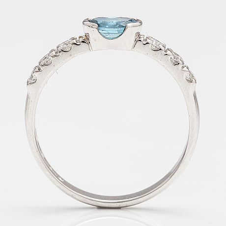 A 14k white gold ring with an aquamarine and diamonds ca. 0.18 ct in total. finland 2016.
