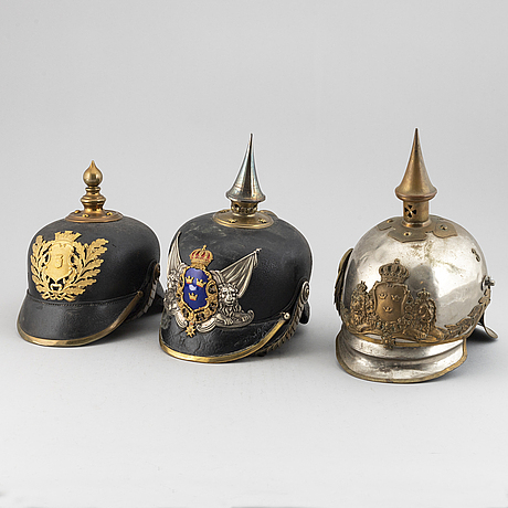 Three swedish military helmets.